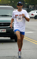 Photo of 1st overall male in the Mass Street Mile.