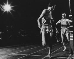 Photo of Dwight Peck receiving baton at 1966 NCAA Indoor Champs.