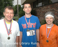 Photo of the Slocums with their medals from the Tongie Library Run.