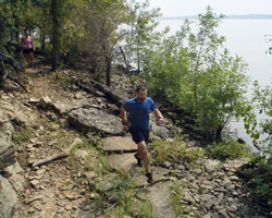 Photo of Levi Bowles on the Shoreline Shuffle course at Clinton Lake.