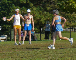 Photo of Jeff Behrens staying something to Dee Boeck at the finish of the Course of Creams XC races.