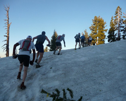 Climbing over snow at the Western States 100.
