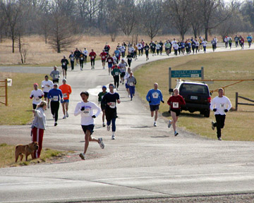 Photo of 5K runners going to their left and 12K runners to their right